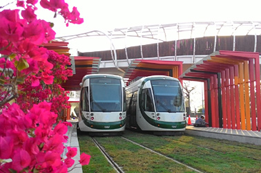 C3 Cianjhen Star Station of the LRT system, trains, and bicycle bridge