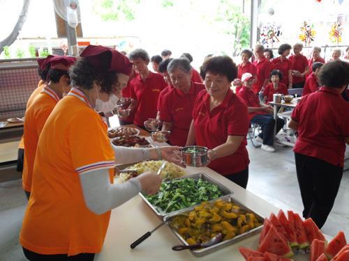 Care station of elder community ~ elders enjoy meals together
