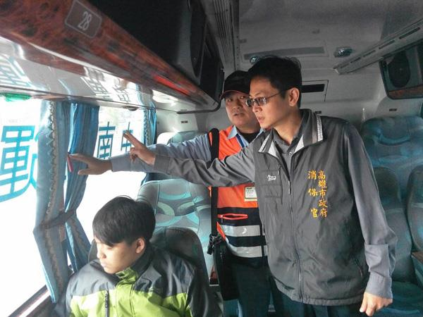 Consumer protection officer conducting coach safety inspection